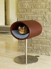 This cat cave is available at pet-interiors.com