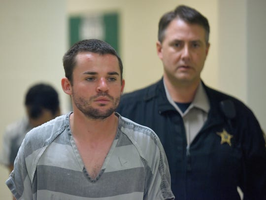 Heath Otto is escorted to court in the Minnehaha County Jail on Monday.