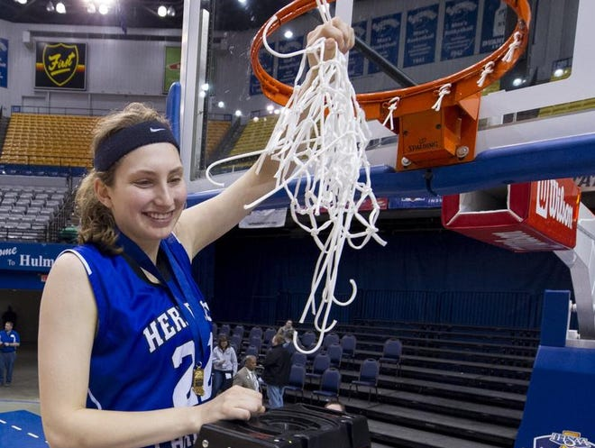 Heritage Christian High School's Natalie Orr (22) celebrates after cutting down the game net after winning the IHSAA Girls Basketball Class 2A Championship, March 8, 2014, in Terre Haute, Ind. Heritage Christian High School defeated Fort Wayne Canterbury High School 64-61.