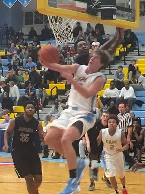 Cape Henlopen's Ian Robertson banks in a reverse layup against Appoquinimink on Tuesday night at Slam Dunk to the Beach.