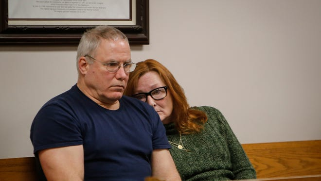 An anxious Byron and Susan Vamvakias of Ionia wait to hear the fate of their son-in-law's dogs, Mario and Luigi, in the chambers of District Judge Raymond Voet's courtroom Monday, April 17, 2017.  Their son-in-law, Allen Hustin, an Iraq War Veteran from Fort Bragg, North Carolina was visiting last July with his dogs. The Vamvakias' German Shepherd, Major, along with Hustin's dogs, got loose and were found inside a pen with three dead goats. A judge on Monday ruled that the dogs should be returned to them.