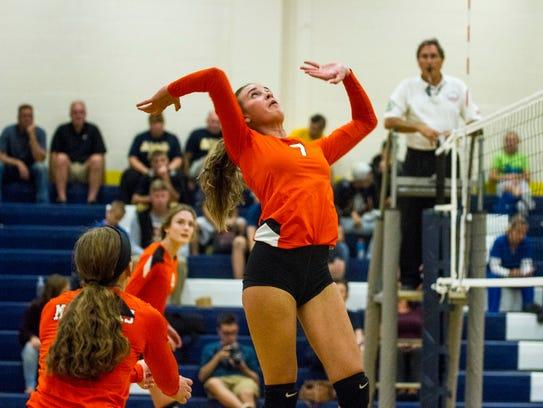 Marine City's Stephanie Abraham goes to hit the ball
