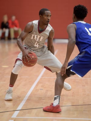 Indiana University East's Jordan Furlow moves the ball against Ohio Christian University's Michael Camp Saturday, Dec. 3, 2016 during a basketball game at IUE in Richmond.