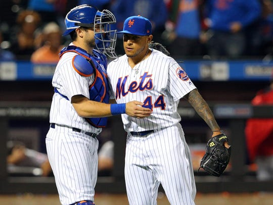 Mets relief pitcher AJ Ramos (44) celebrates with catcher