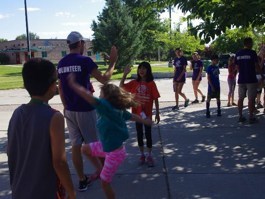 A trio of high school runners helped pass along their love of the sport to a younger crowd this summer in southeast Reno.