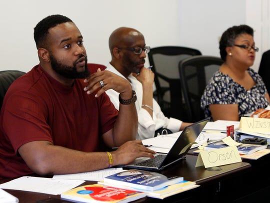 Empower You program assistant Orson Burton Jr. participates