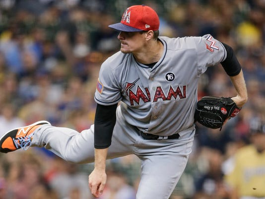 Miami Marlins' Tom Koehler pitches to a Milwaukee Brewers batter during the first inning of a baseball game Saturday, July 1, 2017, in Milwaukee. (AP Photo/Tom Lynn)
