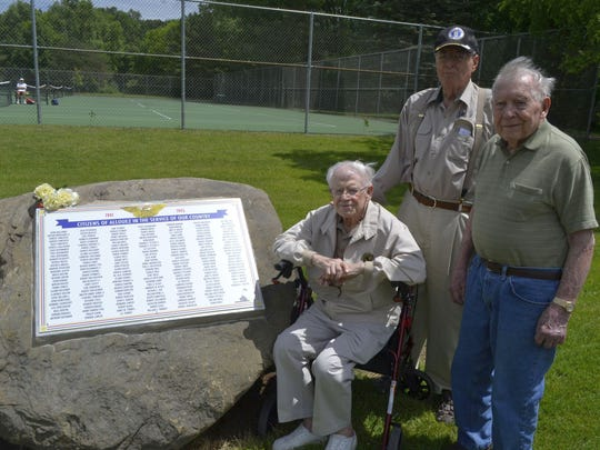 From left, World War II veterans Richard Gay, John Brebner and Robert Mineau stand next to a new marker on a big stone in Green Isle Park in Allouez that honors almost 200 men and women from the village who served in the military during the war.