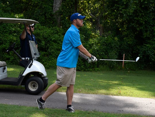 Tim Shaw enjoys a round of golf at McCabe Golf Course