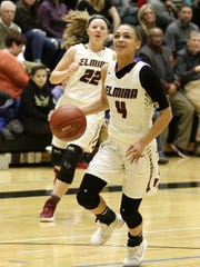 Kiara Fisher of Elmira goes up for a layup as Alexus Boorse watches March 3, 2018 during the Section 4 Class AA championship game against Horseheads at Corning-Painted Post High School.