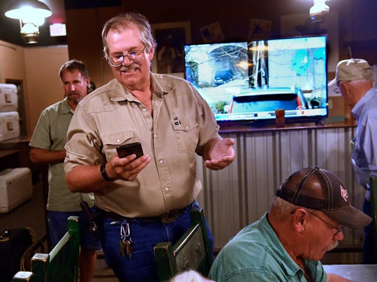 Bruce Kreitler looks at the early voting election information on his phone May 5 informing his supporters that the totals so far indicated he was behind challenger Jack Rentz. Kreitler was running for re-election on Place 2 of the Abilene City Council.
