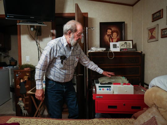 James Peterson checks on his home hemodialysis machine in the bedroom of his Glenville, W.Va. home. Peters worked as a contract welder, repairing heavy machinery at DuPont landfills that contained C8 and now deals with high cholesterol, heart and kidney problems.