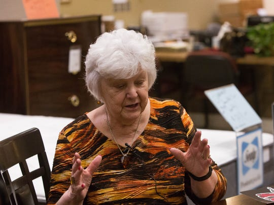 """""""It is the community that supports the university and everyone should be able to have a piece of that history,"""" said Wanda Bowman, owner of Ashley Furniture HomeStore and facilitator of Saturday's auction."""