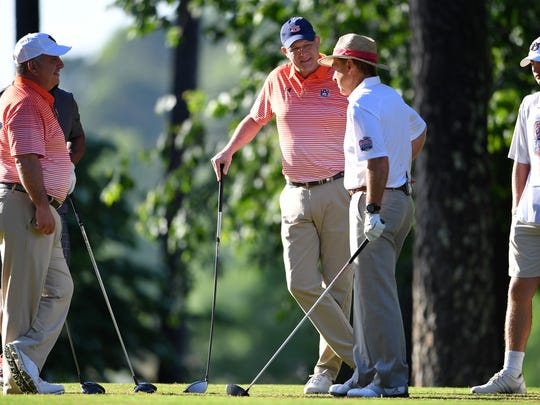 Gus Malzahn and Nick Saban talk on the tee box during the Chick-fil-A Peach Bowl Challenge at the Oconee Golf Course at Reynolds Plantation, Sunday, May 1, 2018, in Greensboro, Georgia.