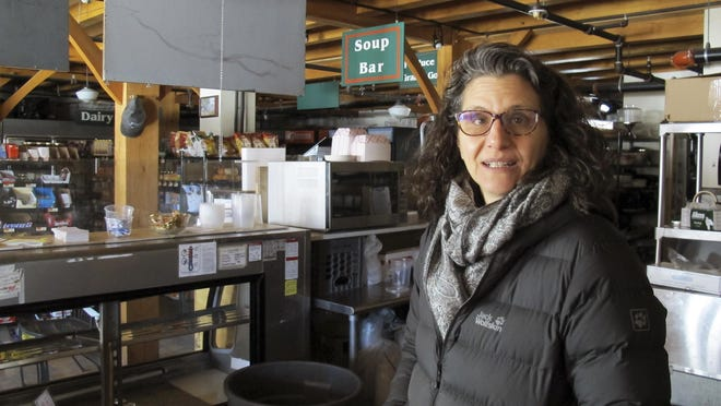 Lyssa Papazian, of the Putney Historical Society, stands inside the closed Putney General Store in Putney. The most recent operators of the store closed it Dec. 31.