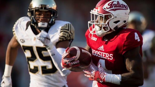 Sep 24, 2016; Bloomington, IN, USA;  Indiana Hoosiers wide receiver Ricky Jones (4) catches a pass and attempts to outrun Wake Forest Demon Deacons defensive back Brad Watson (25) during the second half of the game at Memorial Stadium. Wake Forest defeated Indiana 33-28.  Mandatory Credit: Marc Lebryk-USA TODAY Sports