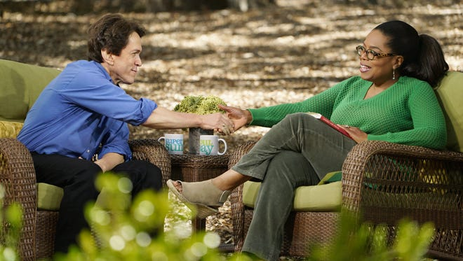 """Mitch Albom shakes the hand of Oprah Winfrey on the set of her show, """"SuperSoul Sunday"""" on OWN. The episode featuring Albom, a Detroit Free Press columnist, will air at 11 a.m.Sunday, Aug. 27."""