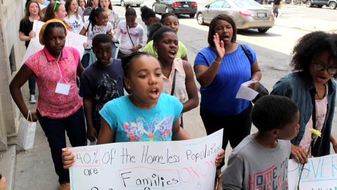 Rothenburg Preparatory Academy students and Miami University student teachers march against poverty, violence, homelessness and injustice near Washington Park in Over-the-Rhine.