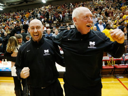 Chad Peckinpaugh, left, celebrates with his father Rick after McCutcheon won the 2016 Class 4A semistate.