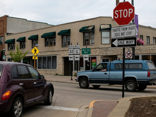 Traffic moves along Main Avenue in De Pere on Tuesday, May 24, 2016.