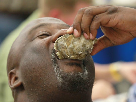 Greg Floyd of Charleston eats an oyster during the Meals on Wheels Oyster Roast at the Civic Center of Anderson.