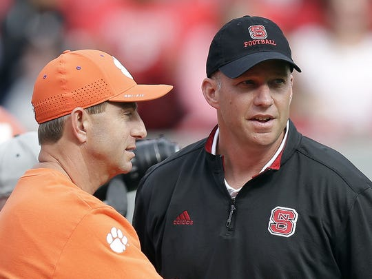 Clemson coach Dabo Swinney (left) and N.C. State coach Dave Doeren chat before the Oct. 31, 2015, game between their two teams in Raleigh, N.C.