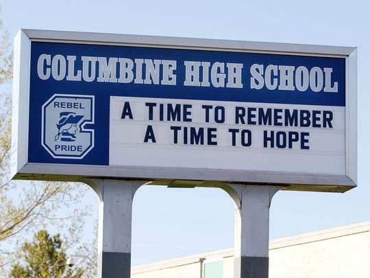 """File photo: A sign at Columbine High School in Littleton, Colo., on April 19, 2004, with the words: """"A Time to Remember, A Time to Hope"""" was the only hint that it was the eve of the fifth anniversary of the massacre of 12 students and one teacher at the school."""