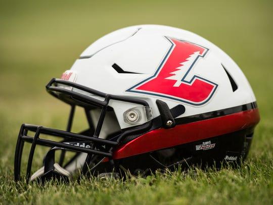 The Lebanon High football team showed off its new helmet