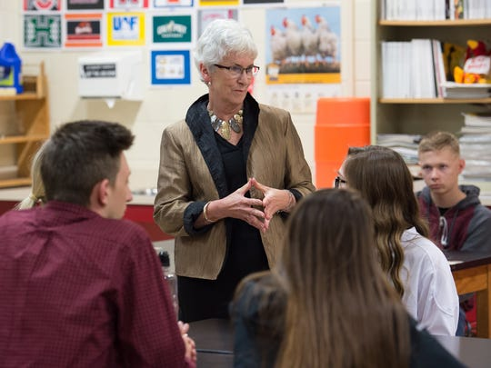 Dr. Susan Bunting, Delaware's Secretary of Education, talks with students after announcing $400,000 in public grants to support new high school pathway programs during a visit to Smyrna High School.