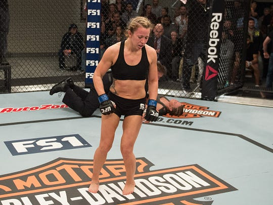 Amanda Bobby Cooper celebrates her submission victory over Mellony Geugjes during 'The Ultimate Figher' elimination fights at the UFC TUF Gym on January 26, 2016 in Las Vegas.