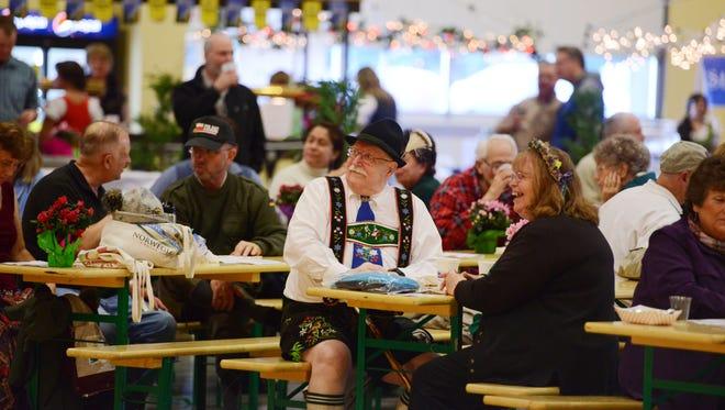 Allen and Nancy White listen to Oregon Polka Beats during Wurstfest in Mt. Angel in 2013. Wurstfest returns Feb. 5-6.