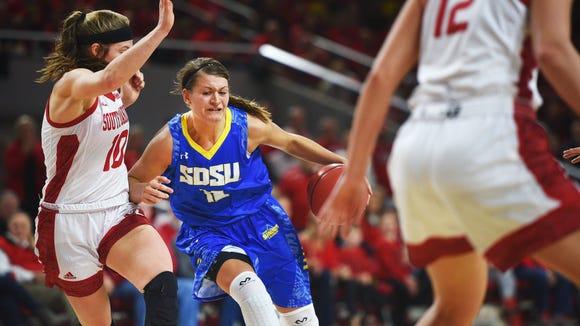 SDSU's Macy Miller runs past USD's Allison Arens during