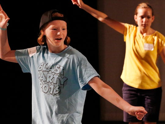 Chloe Seltrecht practices the slide move during dance movement class at the Capitol Civic Center's theater arts camp at UW-Manitowoc on Tuesday, June 21. Chloe is among the twenty-six kids participated the week-long camp.