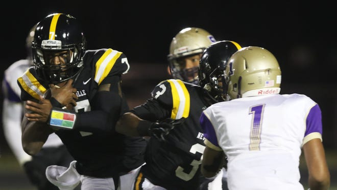 Neville quarterback Jaiden Cole runs the ball during the first quarter of LHSAA Class 4A semifinals against Warren Easton at Bill Ruple Stadium in Monroe on Friday, December 2, 2016. Neither team scored in the first quarter but Cole scored a touchdown approximately two minutes into the second.