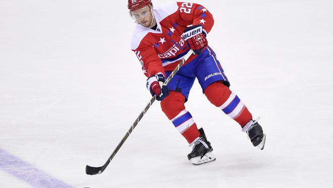 Washington Capitals defenseman Kevin Shattenkirk (22) passes the puck during the third period of an NHL hockey game against the Columbus Blue Jackets, Thursday, March 23, 2017, in Washington. The Capitals won 2-1 in a shootout. (AP Photo/Nick Wass)