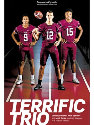 The cover of the fall 2015 AGR special section featuring Earnest Edwards, Jake Zembiec and Jamir Jones of the undefeated Aquinas football team.