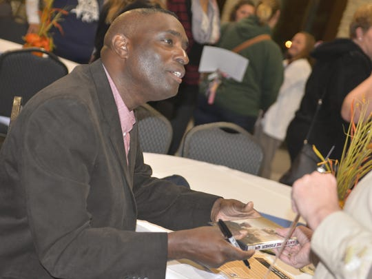 Antwone Fisher signs autographs following The Soul, Science and Culture of HOPE, a presentation through the international organization Kids at Hope. The 2015 event was organized through the Manitowoc County Social Services Department