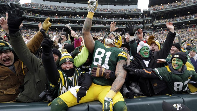 Green Bay Packers tight end Andrew Quarless celebrates with fans after a Lambeau Leap in 2015. Green Bay was named the top football city in the nation in a recent study.