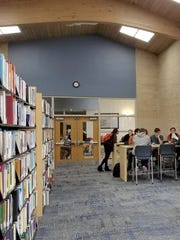 UW-Manitowoc students gather between classes in the newly renovated library space on campus. The library was moved from the second floor to a more central location on campus as part of a recent $7 million renovation project.