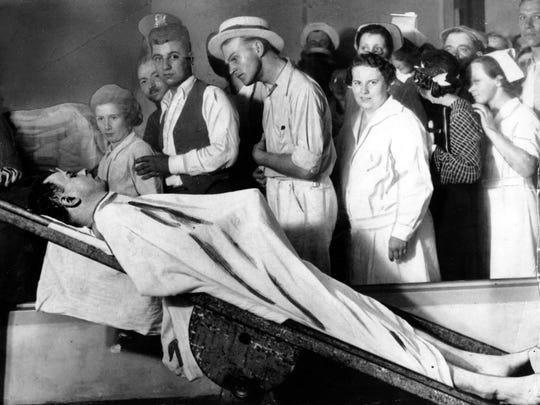 People view the body of gangster John Dillinger in a Cook County morgue in Chicago, December 1934. This photo spurred the urban legend about Dillinger's anatomy.
