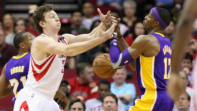Rockets center Omer Asik is not thrilled to play with new addition Dwight Howard.