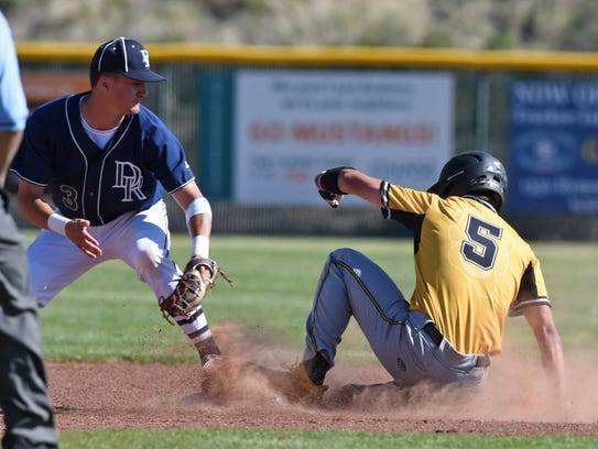 Galena's Austin Crofoot slides into second base after