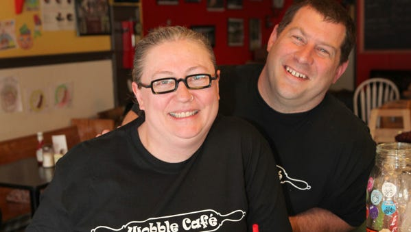Beylka Krupp and Rich Foshay pose with some of their popular dishes at the Wobble Cafe in Ossining, April 24, 2013. ( Joe Larese/The Journal News )