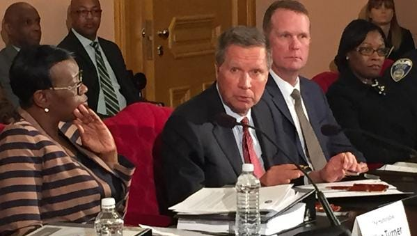 Gov. John Kasich, joined by African-American and law enforcement leaders, signed an executive order Wednesday that would lead to the establishment of statewide standards for police use of deadly force.