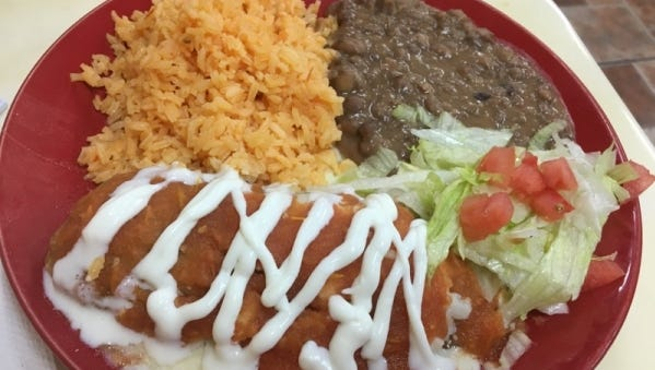 La Hacienda Supermarket and Taqueria's chile relleno was a large poblano pepper filled with melted queso cheese encased in an egg batter and lightly fried then topped with a tomato based sauce and sour cream squiggle. It was served with Spanish rice and beans.
