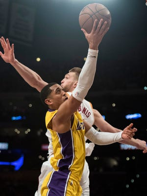 Los Angeles Lakers guard Jordan Clarkson, front, goes up for a basket past Indiana Pacers center Domantas Sabonis on Friday. Clarkson had a season-high 33 points.