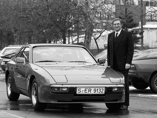 Peter W. Schutz next to the Porsche 944, 1982 in front