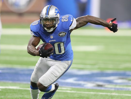 Lions receiver Anquan Boldin catches a pass against