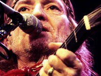 Willie Nelson is performing for the crowd at the State Fairgrounds during the night concerts of the 1984 Tennessee State Fair on Sept. 14, 1984.