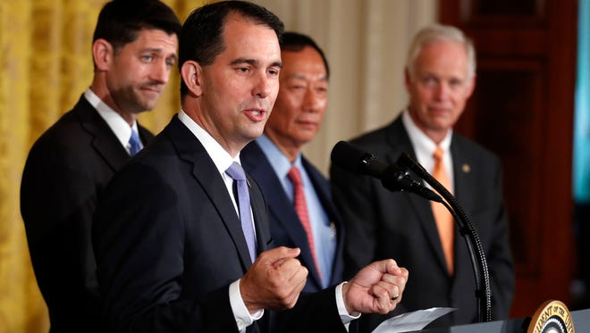 Wisconsin Gov. Scott Walker speaks in the East Room accompanied by House Speaker Paul Ryan of Wis., Foxconn CEO and founder Terry Gou, and Sen. Ron Johnson, R-Wis., at the White House in Washington, Wednesday, July 26, 2017. Trump said that electronics giant Foxconn will build a $10 billion factory in Wisconsin that's expected to create 3,000 jobs.(AP Photo/Carolyn Kaster) ORG XMIT: DCCK201